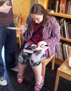 Me at a party flicking through The Mammoth Book of Erotic Photography